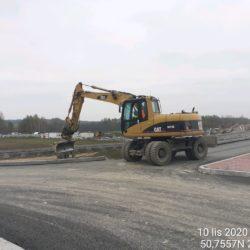 Wykonanie zasypki obrzeży betonowych przy obiekcie WD-14 na rondzie strona prawa 14+029