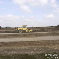 Zagęszczanie podbudowy na drodze dojazdowej 15+400