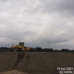 Wykonanie zagęszczania podbudowy drogi dojazdowej 14+900